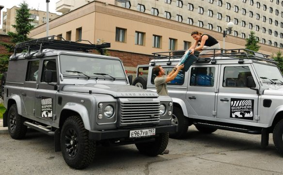 Jenny & Jiri unpacking a Land Rover