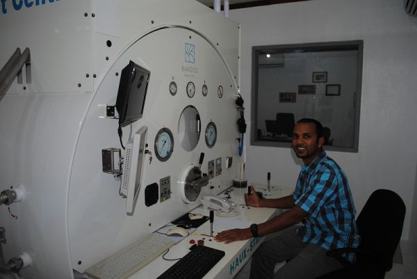 Ahmed Wafir, Manager, Bandos Medical Centre sitting at the controls of their state of the art hyperbaric chamber