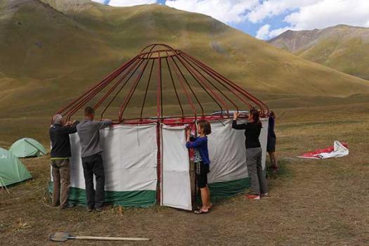Trevor, Nigel, Miyana, Laura and Nicola taking down the yurt